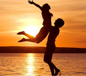 Ideal couple dancing on the beach